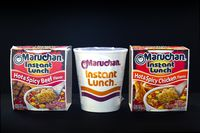 Calgary, Alberta, Canada. Oct 30, 2020. Beef and Chicken Instant Maruchan Noodle soup on a black background.