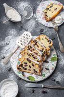 Cottage cheese pie with raisins sprinkled with powdered sugar.