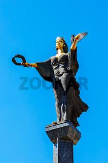 The Famous Golden Statue of St. Sofia in Sofia, Bulgaria. The statue represents Saint Sofia