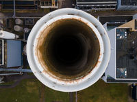 Coal central aerial drone shot chimney pipe energy recovery plant Hemweg in Amsterdam The Netherlands industrial facility