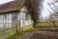 old farmhouse at autumn time