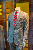 Mannequin in a shop window. Sale of clothes for men.