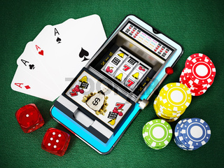 Online gambling concept. Smartphone, roulette,playing cards, chips and dice. 3D illustration