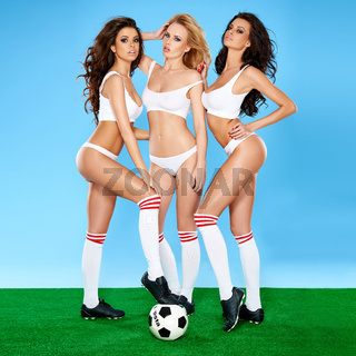 Three beautiful sexy women soccer players