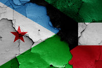 flags of Djibouti and Kuwait painted on cracked wall