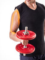Crop of sportsman exercising with dumbbell with adhesive tape on arm