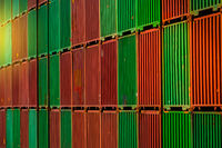 Stacked shipping container for global economy and commerce background -