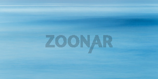 Long exposure of sea water, blue abstract background