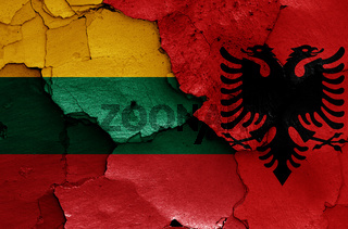 flags of Lithuania and Albania painted on cracked wall