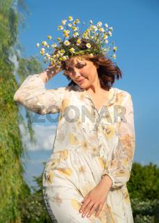 Beautiful romantic brunette adult woman posing outdoors