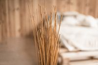 Bunch of straw close-up in the bedroom decor. Blurred background. Dry grass as an element of decor. High quality photo