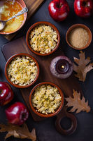 Small apple crambles or apple pies for autumn and winter