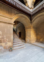 Staircase with wooden balustrade leading to an old abandoned historic building, Cairo, Egypt