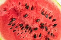 The pulp of a red ripe watermelon with seeds