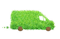 Isolated delivery van made of leaves and wood. Electric cargo car, transportation and environmental