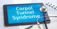 The word Carpal Tunnel Syndrome on the display of a tablet