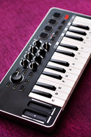 Close up image midi electronic musical keyboard, modern device, vertical image view from above, no people