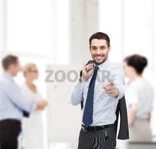 handsome buisnessman with jacket over shoulder