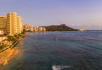 Aerial view of Waikiki beach towards Diamond Head at sunset