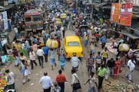 Kolkata, India, Street scene with crowds of people and traffic in the Indian metropolis