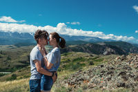 Loving couple together on mountain