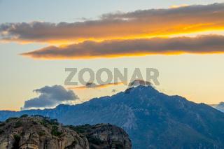 Golden Post-Sunset Sky and Mountain Peaks