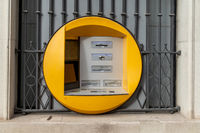close up of a round yellow ATM cash point machine