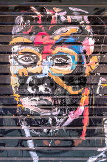 Colorful human face on graffiti artwork
