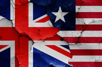 flags of UK and Liberia painted on cracked wall