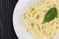 Pasta with sauce and basil