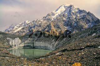 Lake on Engilchek glacier under peaks of scenic Tian Shan mountain range in Kyrgyzstan