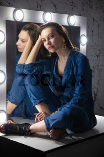 Attractive woman dressed in denim overalls