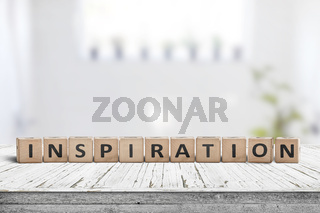 Inspiration sign on a wooden table