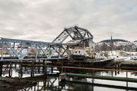 The lifting bridge Skansen jernbanebru in the port of Trondheim on overcast winter day