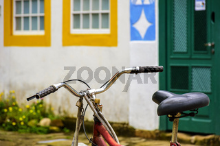 Old bicycle stopped in front of the colonial style houses