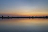 summer dawn over a calm lake