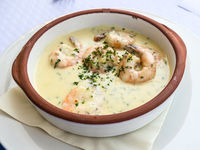 Ramekin of prawns with cream in plate