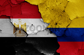 flags of Egypt and Colombia painted on cracked wall