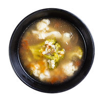top view of broth with stelline and vegetables