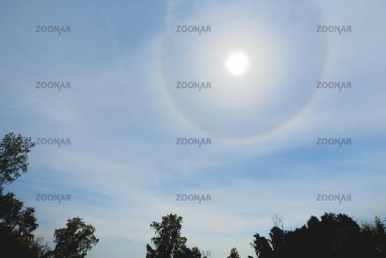Atmospheric optical effect circle around the sun on hot summer day. Atmospheric halo phenomenon around the sun