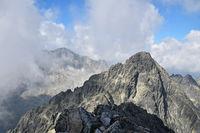 Rocky mountain ridge in foggy clouds
