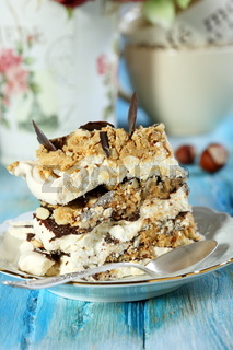 Piece of cake of meringue and chocolate.