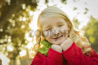 Little Girl Wearing Winter Coat and Scarf at the Park