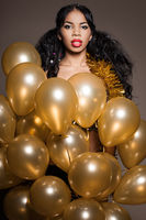 woman with many golden balloons