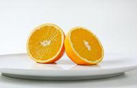 Two fresh orange halves