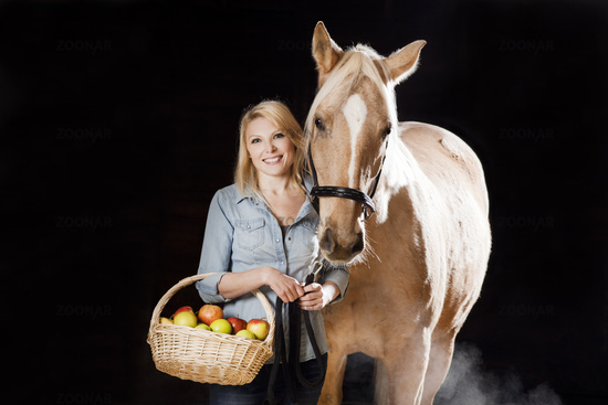 Woman and horse with apples