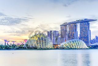 Skyline and Singapore garden by the bay along Marina Bay East river illuminated at dusk