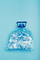 Squashed empty plastic bottle collected to recycling
