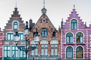 Colorful old brick house on the Grote Markt square in Bruges