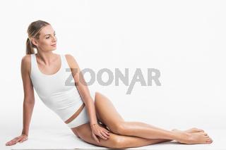 Woman sitting in white underwear